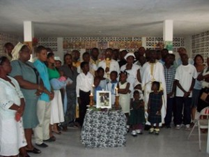 Members of Nativity Parish in Port-au-Prince pose<br/> after serving a funeral service for<br/>the victims of the earthquake of Jan. 12, 2010.