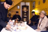 Monastery brethren share<br>their trapeza with parishioners.