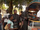 Frs. Frefiure and Jean<br>distribute aid to parishioners. April 2010.