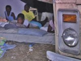 Haitian family sleeping<br>outside after earthquake.<br>Credits: VOA