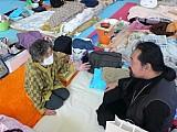 Bishop Seraphim <br/>visits a parishioner at a shelter.