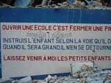 Sign on Fr. Jean's school:<br>