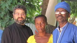 Fr.Demetrio Romeo and Fr.Jean <br/>Chenier-Dumais with a parishioner.