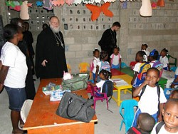 Metropolitan Hilarion visits a parish school in Port-au-Prince.at