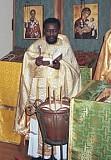 Fr. Christopher Walusimbi<br>serves Liturgy in Beltsville, MD.