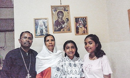 Fr. Aleksaner pictured with his wife Matushka Viktoria and two daughters Crescent and Mary Grace