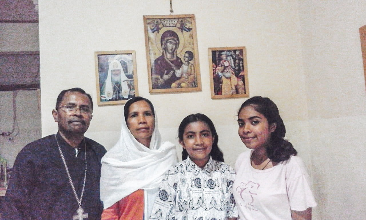 This is Fr. Aleksander with his family! Matushka Viktoria, Crescent, and Mary Grace