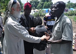 Fr. Daniel McKenzie, administrator<br>of the Haiti ROCOR mission, meets <br>parishioners in Port-au-Prince.<br>April 2010 photo: Serge McKenzie