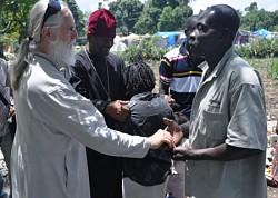 Fr. Daniel McKenzie, administrator<br>of the Haiti ROCOR mission, meets <br>parishioners in Port-au-Prince.<br>April 2010 photo: Serge McKenzie