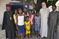 Frs.Gregoire Legoute, Daniel McKenzie and<br>Jean Chenier-Dumais pose with parishioners<br>in front of Nativity church in Port-au-Prince.<br>April 2010. Photo: Serge McKenzie.