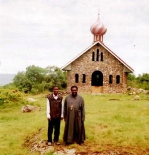 In front of the half-completed church.